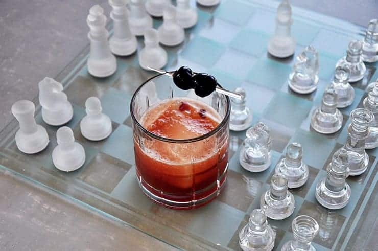 Manhattan cocktail on a glass chess board