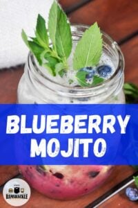 """Blueberry Mojito"" with a mason jar full of the cocktail."