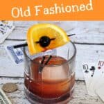 """""""Mad Men Old Fashioned"""" with a drink garnished well on a table"""