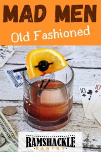 """Mad Men Old Fashioned"" with a drink garnished well on a table"