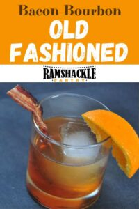 """Bacon Bourbon Old Fashioned"" with a drink underneath in a lowball glass. Garnished with an orange and bacon."