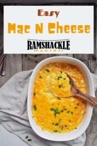 """""""Easy Mac N Cheese"""" with an overhead shot of this homemade macaroni and cheese recipe. There is a wooden spoon in the cheesy mac"""