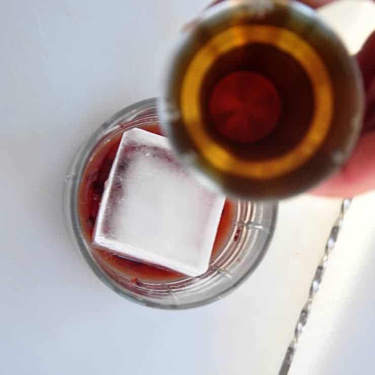 pours whiskey