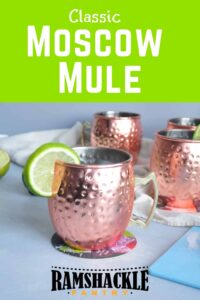 """""""Classic Moscow Mule"""" with a few copper mugs in the background."""