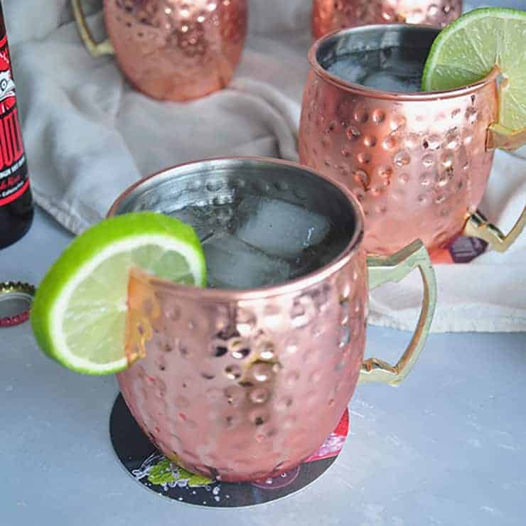 Perfect Moscow Mule recipe in a copper mug with a lime