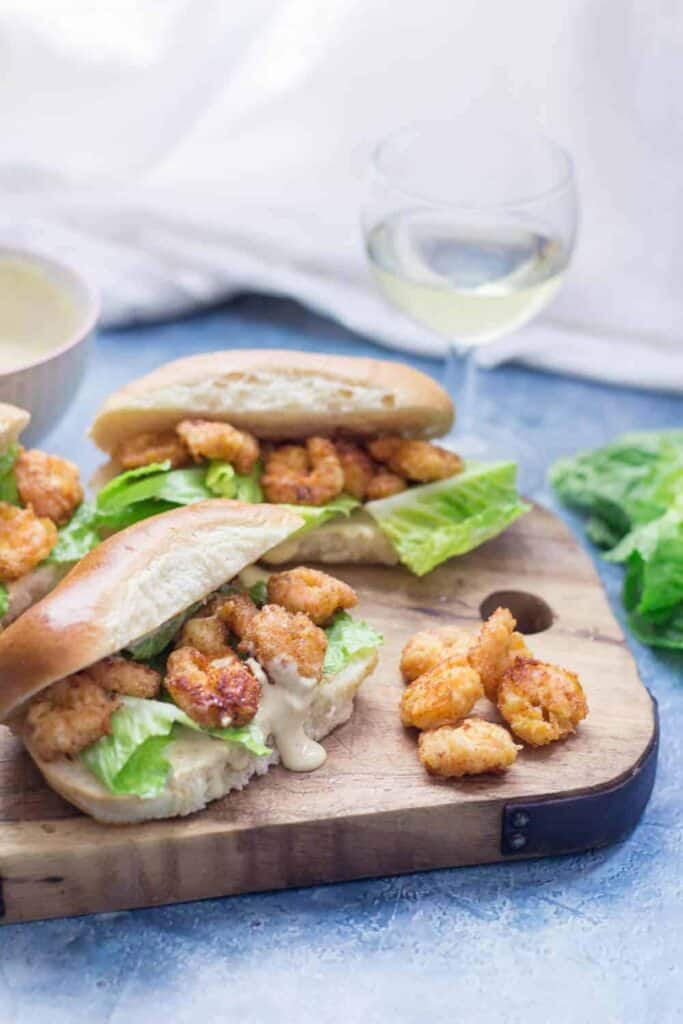 Two Prawn Po Boy Sandwiches on a cutting board