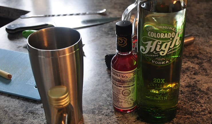 grasserac ingredients on counter - peychaud's bitters, absinth, whiskey, and hemp vodka