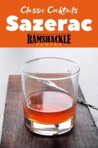 "A simple Sazerac cocktail on a wood platter and the text ""Classic Cocktails Sazerac"" text right above it"