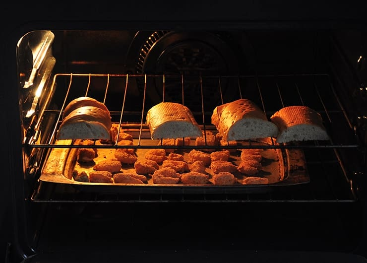shrimp and french bread in oven baking