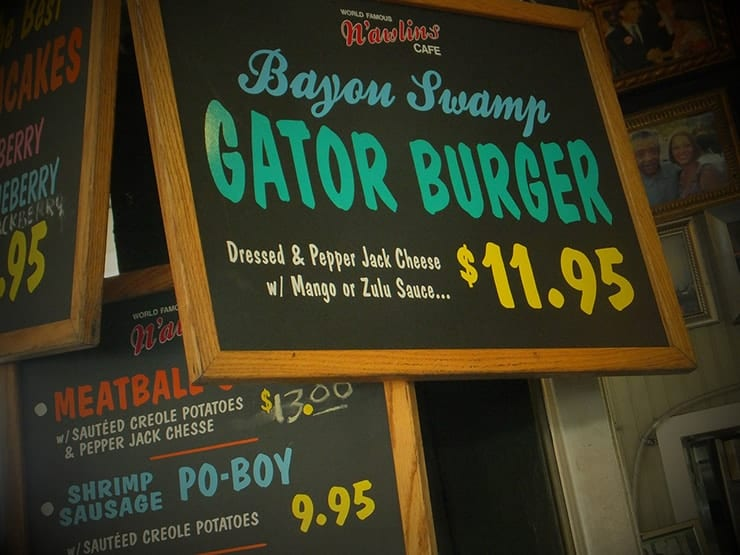 Sign from Bayou Swamp restaurant selling a gator burger for 11.95