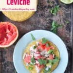 Grapefruit Ceviche on a white plate and rustic pan. There are spent citrus shells laying on the sides.