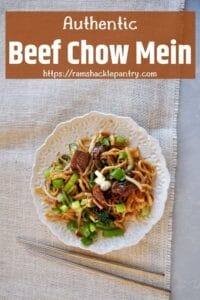 Authentic Beef Chow Mein on a white plate and on a white mat.
