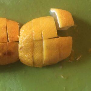 cut up lemon on cutting board