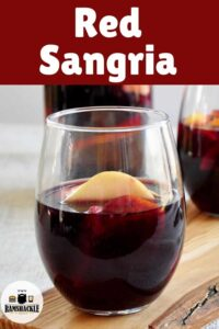 One glass of Red Sangria on a wood plank.