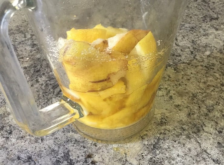 pitcher with pear, lemon, mango, sugar, and brandy in it just waiting for wine to be the final Sangria ingredient