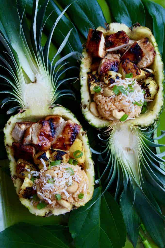 Two pineapples filled with delicious huli huli chicken and rice