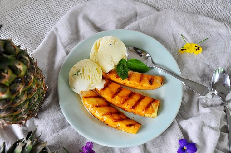 completed sriracha honey grilled pineapple with a basil ice cream