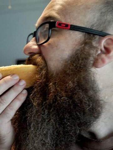 Ramshackle Ben eating a hot dog