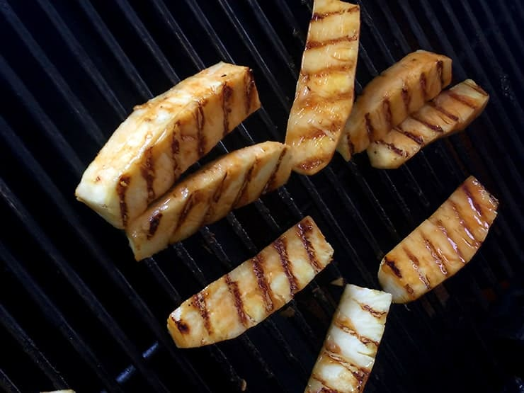 Grilling pineapple with good grill marks on one side
