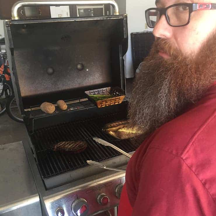 Me Looking back as I am searing my ribeye. Just grilling steak.