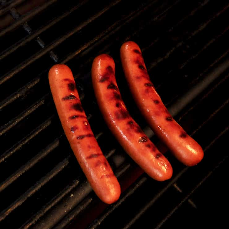 Three Ambassador Weiners on my Weber Grill