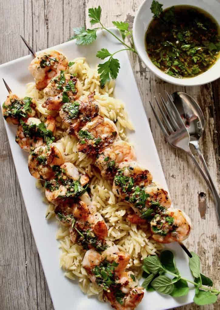Grilled Shrimp on a plate of orzo and chimchurry