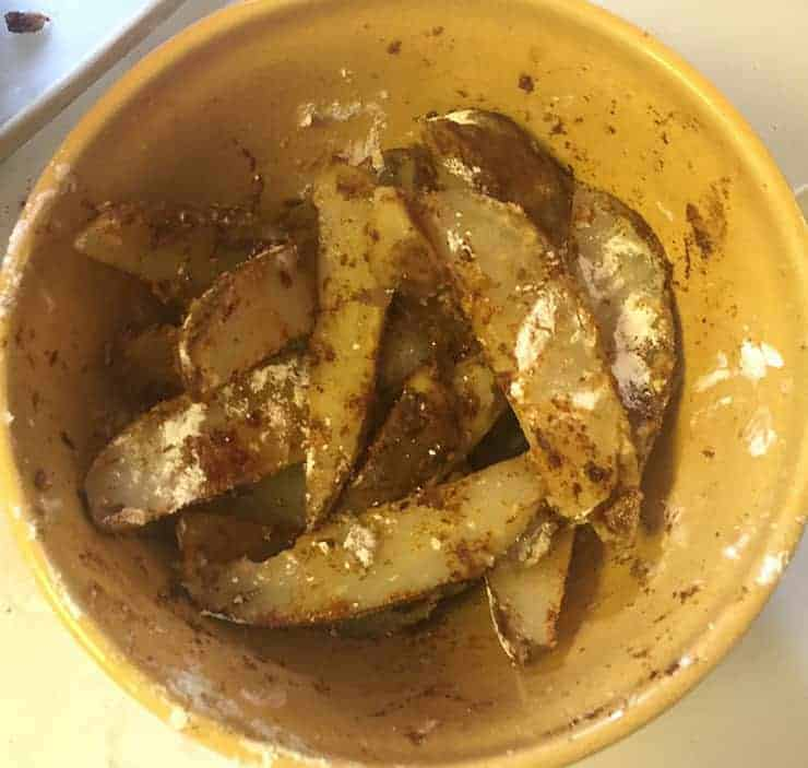 Following the boil and right after I mixed all the seasonings in with the potato wedges.
