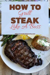 """""""How To Grill Steak Like A Boss"""" With a picture of a big ribeye, buttered corn, asparagus, and loaded baked potato on a white plate"""