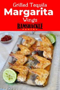 """""""Grilled Tequila Margarita Wings"""" and a platter of the wings and a few limes in the background."""