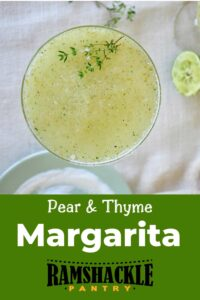 """""""Pear & Thyme Margarita"""" with an overhead picture of the frozen drink and garnished with thyme."""