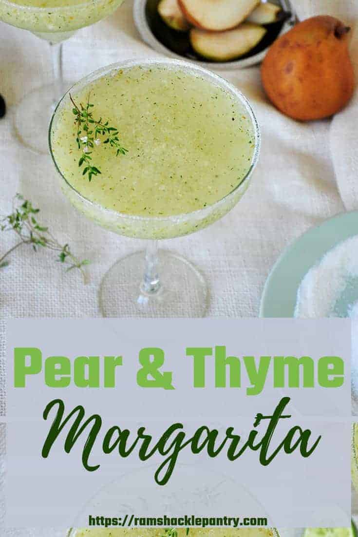 A new Margarita recipe that tastes absolutely divine! This Frozen Pear & Thyme Margarita perfectly pairs with a hot Summer day. This blender drink is cool, yummy, and has all of the great flavors of a classic margarita... kicked up a notch. #margarita #pear #thyme #frozen