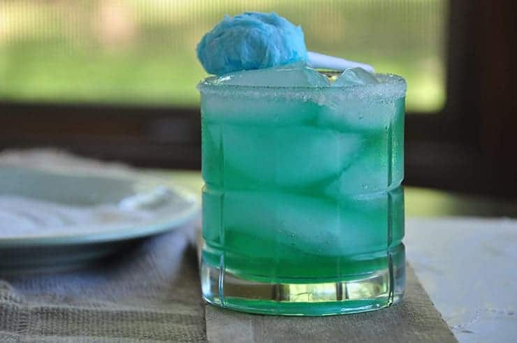 Cotton Candy Margarita on a table with a window in the background