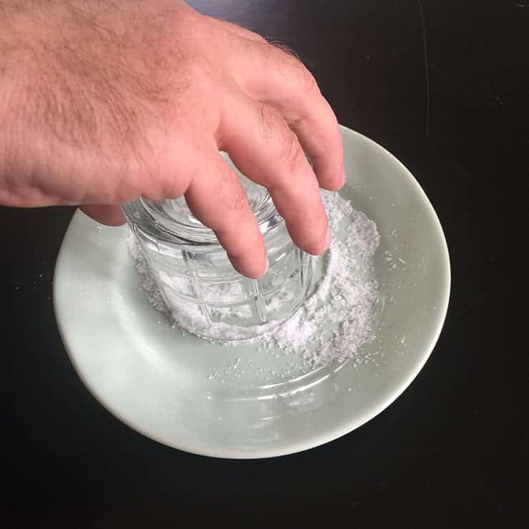Rimming the plate with salt in a light green dish