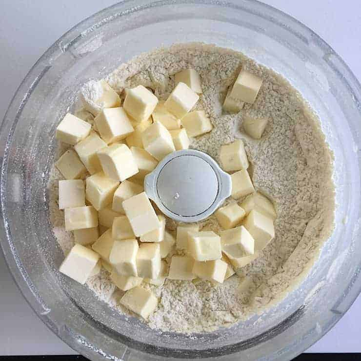 Flour and butter in food processor before it has been pulsed.