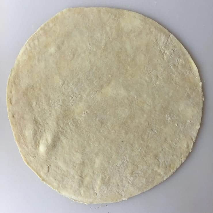 Pie Crust circle with spots of Butter