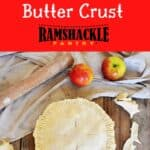 """""""Apple Pie Butter Crust"""" with a view of an apple pie with excess dough trimmed away and apple shown in the background."""