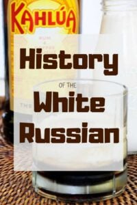 """history of the White Russian"" with a cocktail and bottle of the drink in the background."