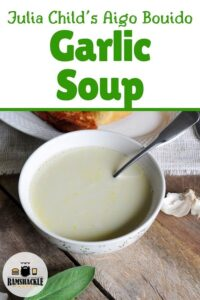 Julia Child's Garlic Soup with a picture of the soup in a white bowl.
