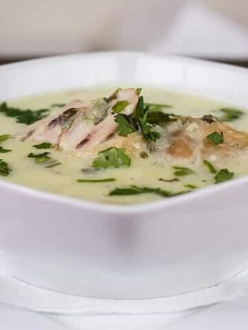 Creamy Chicken Soup in a white bowl that is in a white plate.