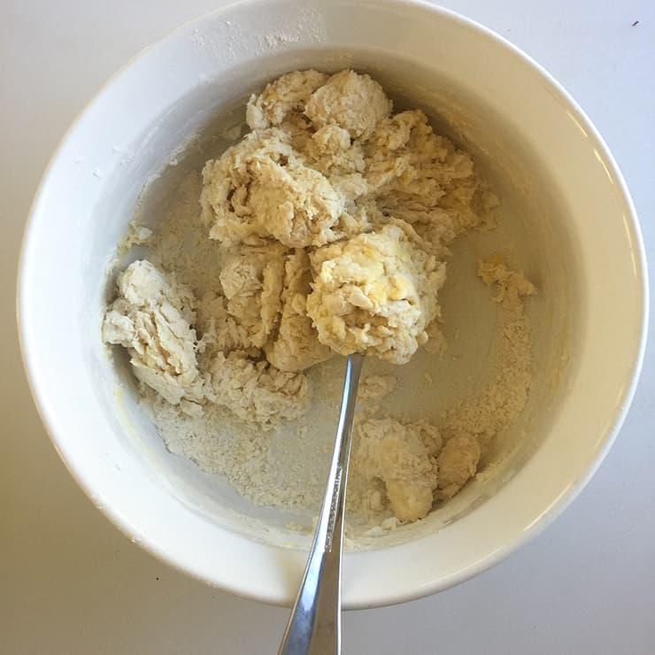 Mixing knoephla dumpling dough in a white mixing bowl
