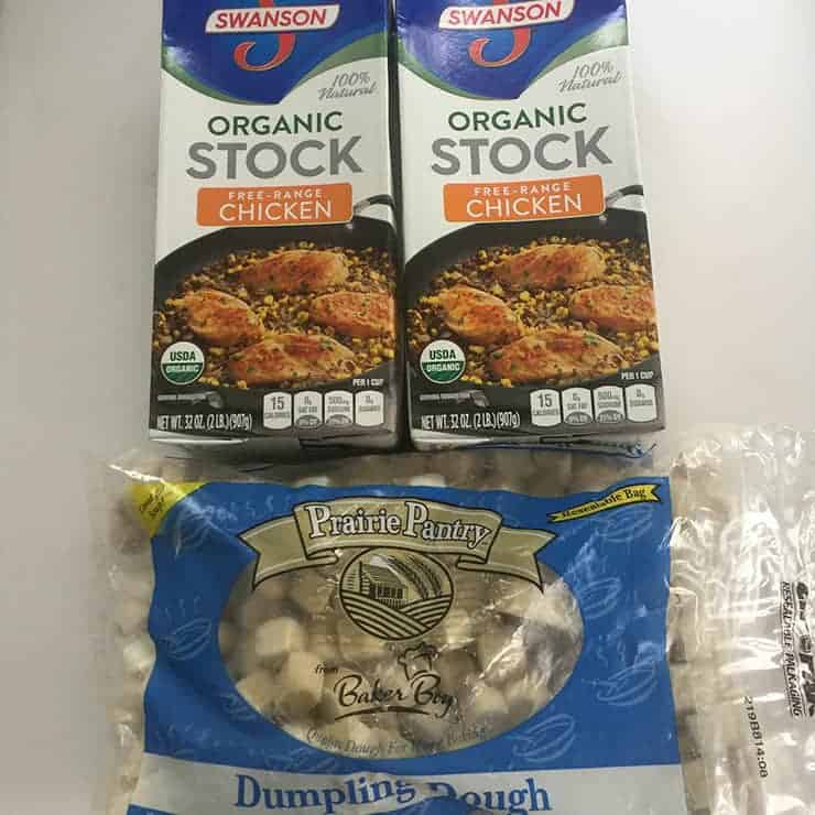 Frozen Knephla Dumplings and two boxes of Swanson's Organic Chicken Stock