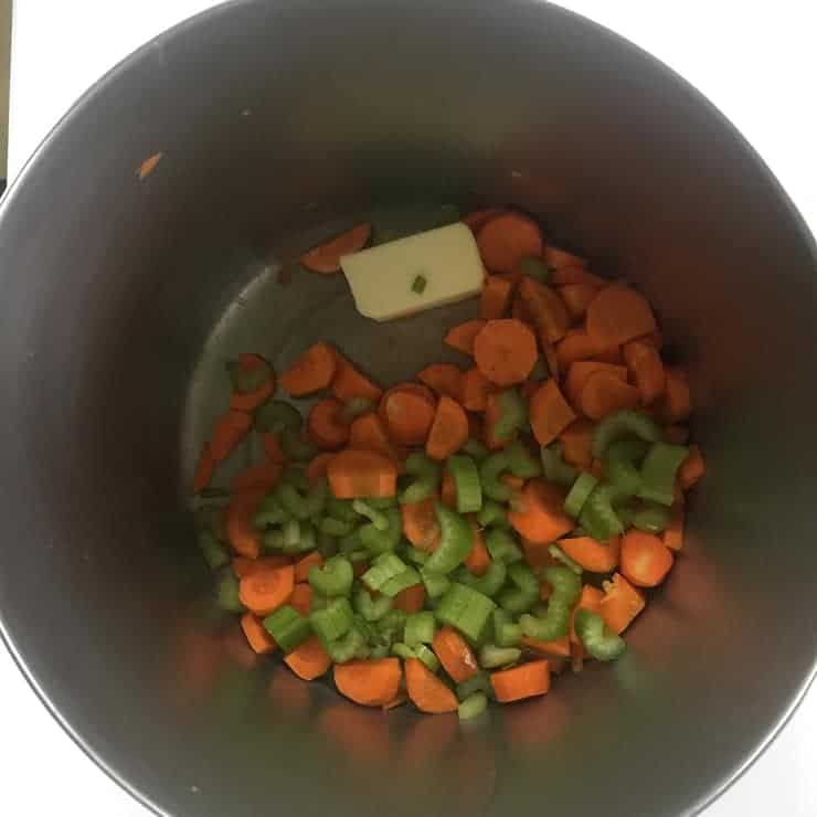 Cut carrots, celery, and butter in soup pan