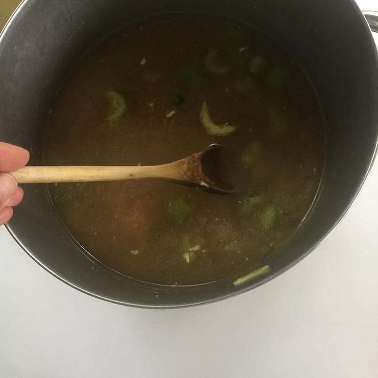 Stirring soup before the dumplings or cream is added