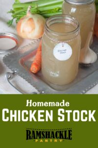 """""""Homemade Chicken Stock"""" with a mason jar full of the stock on a platter with some of the ingredients."""