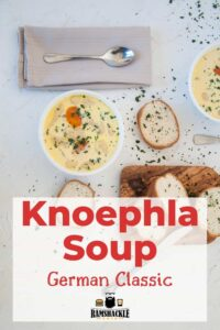 Knoephla Soup - German Classic - overhead bowl with bread and parsley sprinkled over the top.