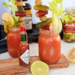 Two Bloody Mary recipe cocktails with all of the fixings