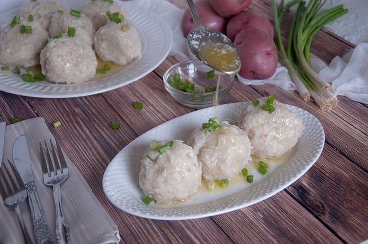 Pouring melted butter onto a klubb dumpling