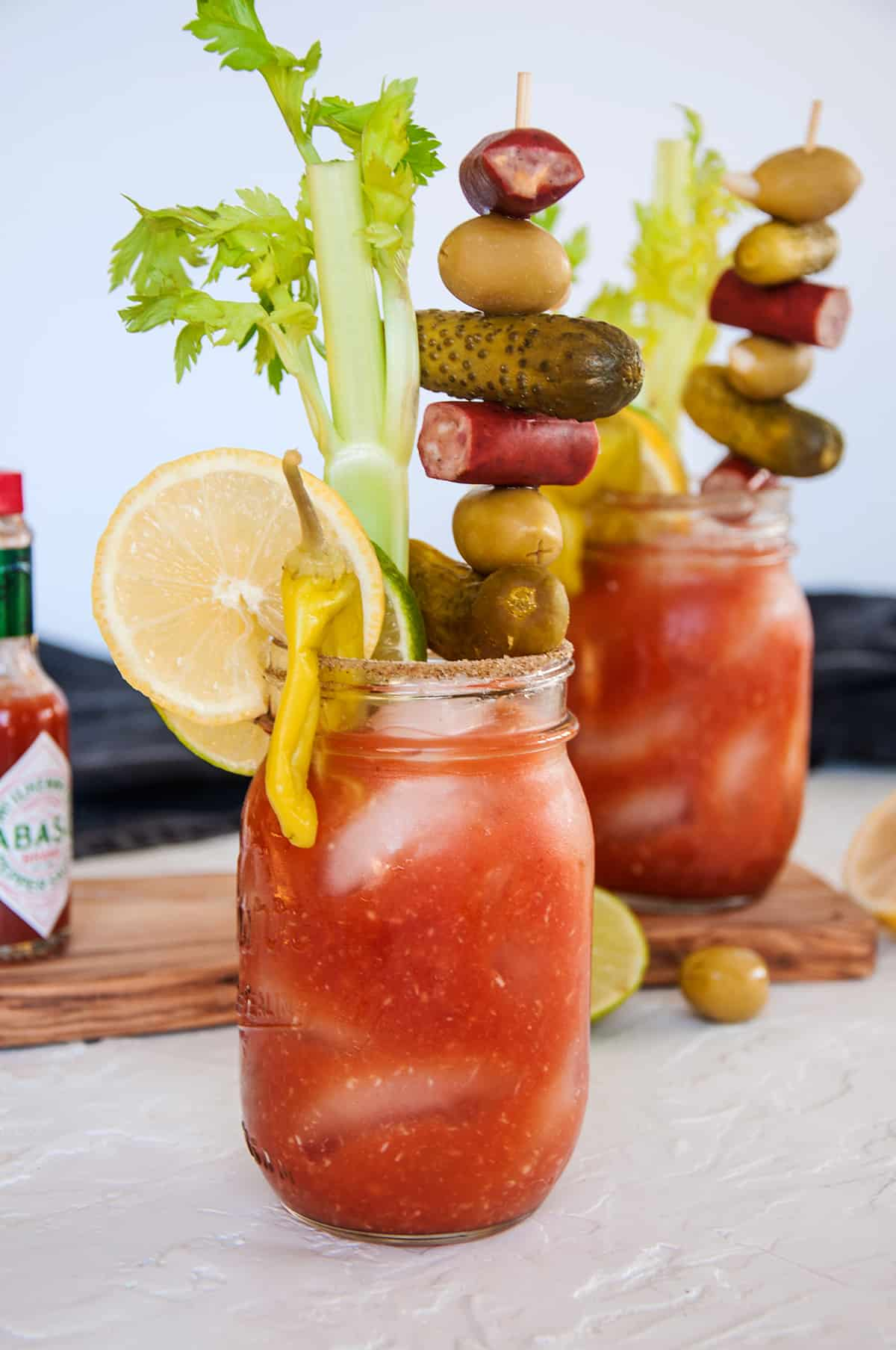 A good look at two stacked bloody mary drinks.