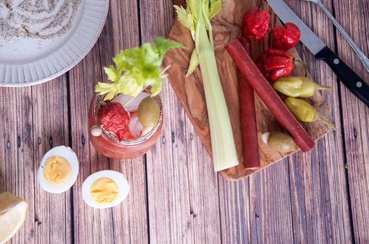The Super Spicy Bloody Mary and sides all on a picnic table