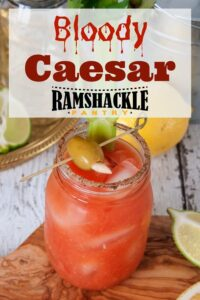 """Bloody Caesar: with an image of the cocktail on a wood platter"